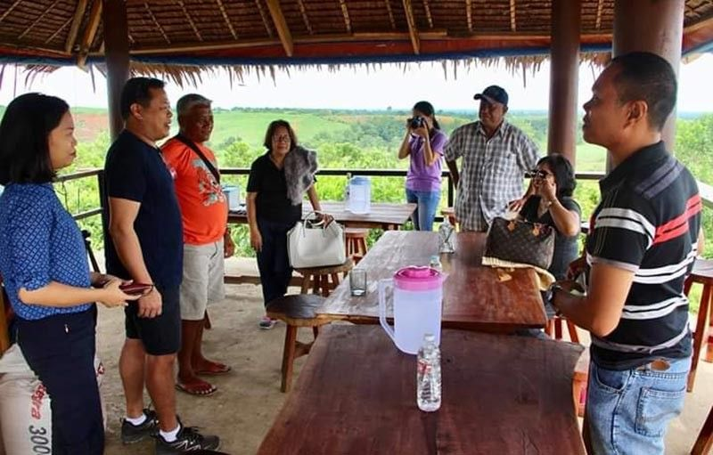 Provincial Supervising Tourism Operations Officer Cristine Mansinares (left) with representatives of various government agencies and offices in Negros Occidental and members of the Dalayapan Agrarian Reform Cooperative during the assessment of its proposed ecopark park at Barangay Caduha-an in Cadiz City on Friday.