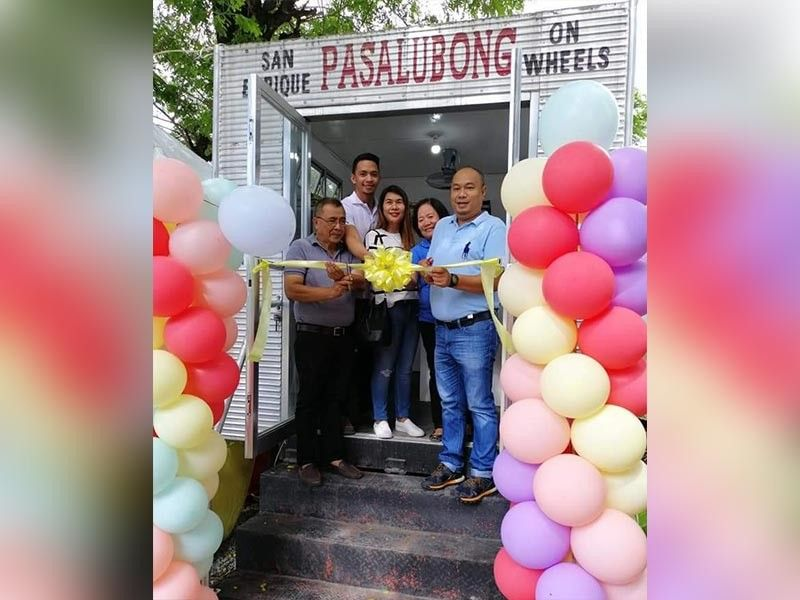 DTI-Negros Occidental Senior Trade and Industry Development Specialist Engiemar Tupas (right) with local government officials headed by Mayor Jilson Tubillara (left) during the opening of Otop Store Express at Barangay Poblacion in San Enrique on Monday, July 8.