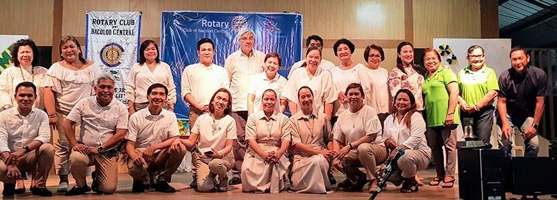 The Centralians with fellow Rotarians, partners and guests. (Contributed Photo)
