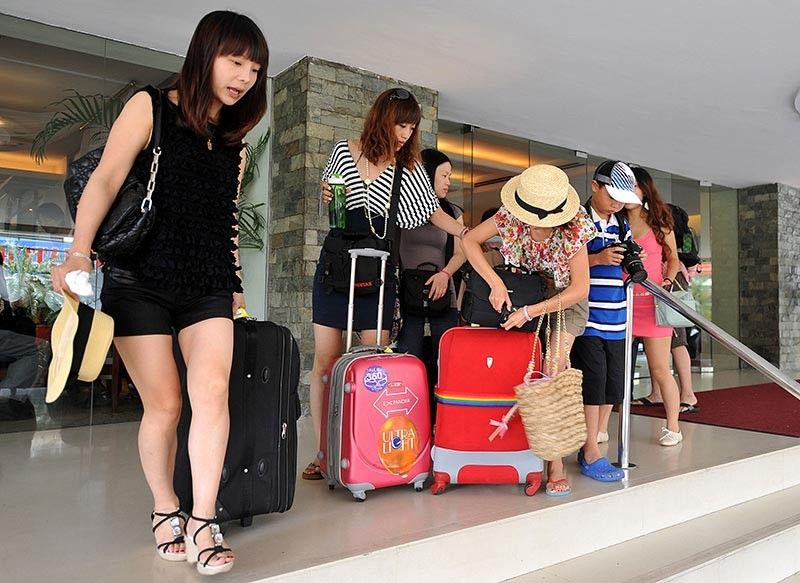 SUSTAINED CHINESE ARRIVALS: Tour groups in Cebu anticipate strong arrivals from China despite its weaker yuan. Angelita Dy, president of the  Cebu Tours and Travel Association, says Cebu's direct con-nection to China will fuel sustained growth in arrivals. (Sunstar  File)