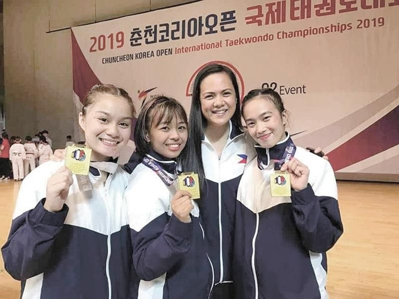 CEBU'S PRIDE. Rinna Babanto (right) and Aidaine Laxa (left) pose for a photo with teammate Jocel Lyn Nibola (second from left) and coach Rani Ann Ortega  after winning the gold medal in the Chuncheon Korea Open International Taekwondo Championships 2019. (Contributed Photo)