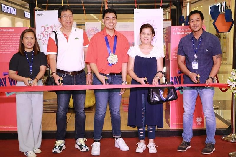 PAMPANGA. Kapampangan artist Gian Wong (center) is holding a one-man Typographic Exhibit at SM City Clark, which opened last Sunday, July 7, 2019. Joining him are (L-R) Assistant Mall Manager Engr. Allan Dale Parungao, Wong's parents Manuel and Remy Wong and Christina Mugot, Regional Marketing Manager. The exhibit will run until July 31. (Chris Navarro)