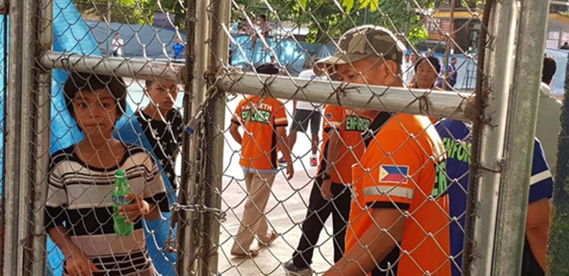 CAGAYAN DE ORO. Village watchmen padlock the disputed Nazareth Lawn Tennis courts in Cagayan de Oro. Barangay Nazareth chair Maximo Rodriguez III intends for the disputed area to be demolished and converted into a multi-purpose building. (Contributed photo)