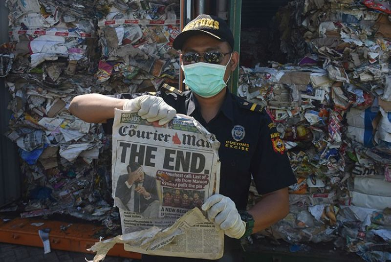 INDONESIA. Indonesian custom officers show off the front of a foreign newspaper among waste found in a container at the Tanjung Perak port in Surabaya, East Java, Indonesia, Tuesday, July 9, 2019. (AP)