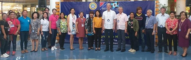 BACOLOD. PCCI-Western Visayas governor Donna Rose Ratilla (right) with Governor Eugenio Jose Lacson (eight from right), MBCCI officials headed by president Roberto Montelibano (seventh from right) and chief executive officer Frank Carbon (fourth from right), provincial supervising tourism operations officer Cristine Mansinares (ninth from right) and tourism officers in the province during the opening of the 11th Negros Business Week at Robinsons Place Bacolod running from July 6 to 17 this year. (Erwin P. Nicavera)