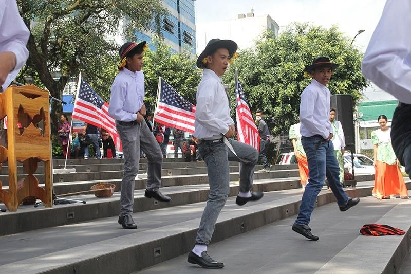 BAGUIO. Dressed in cowboy attire, students from Pines City National High School showcase the influence of Americans through a dance performance during the celebration of Filipino-American friendship day at the Malcolm Square. Photo by Jean Nicole Cortes