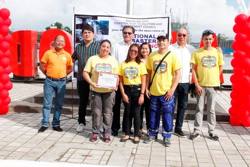 BACOLOD. Vice Mayor El Cid Familiaran, and Councilors Bart Orola, Israel Salanga, Archie Baribar, and Simple Distrito give certificates of appreciation to Chamber Volunteer Fire Brigade for their commitment and partnership to community service at the program to kick off the 2019 Disaster Resilience Month, at the Bacolod City Government Center grounds. (Photo by Bacolod City PIO)