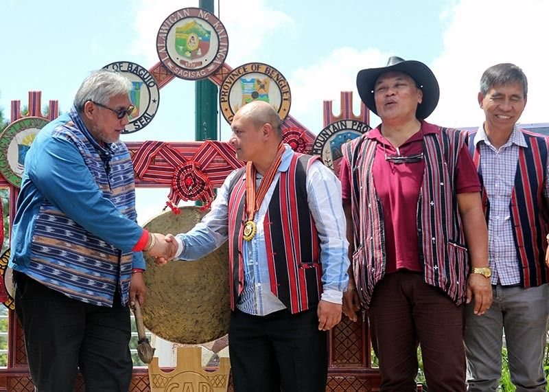 BAGUIO. Baguio City Vice Mayor Faustino Olowan greets Benguet Governor Melchor Diclas and other Benguet officials at the City Hall grounds during the Unity Gong Relay in celebration of the Cordillera Month. (Jean Nicole Cortes)