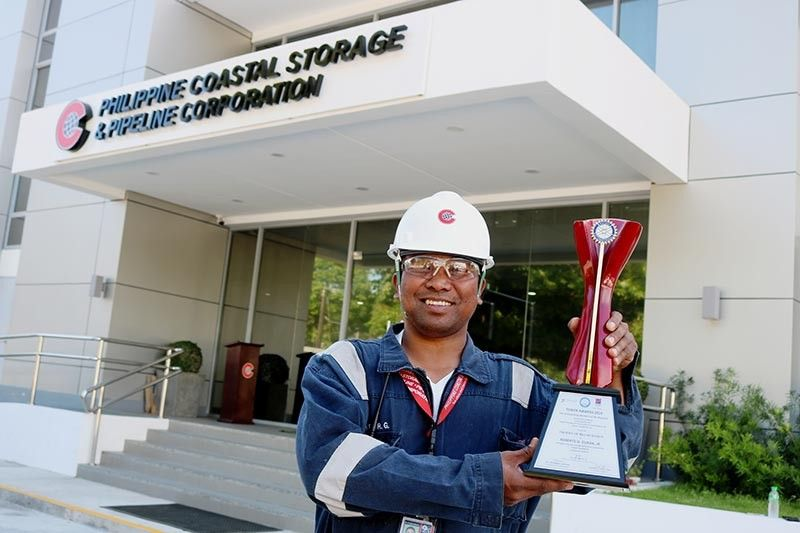 "PAMPANGA. Subic worker Roberto Duran proudly shows his award as one of ""The Outstanding Workers of the Republic"". (Contributed photo)"
