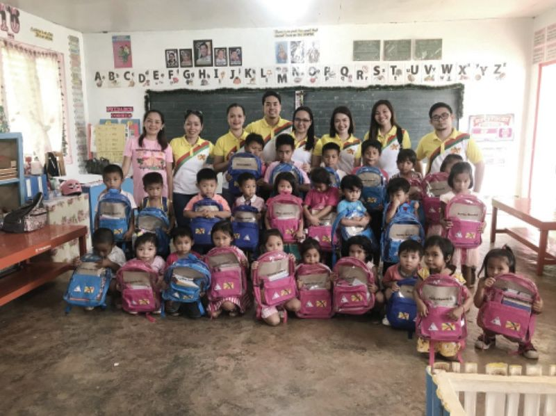 GOTHONG'S GENEROSITY. Kindergarten children of Cambagocboc Elementary School in Barangay Sunog, Balamban, Cebu receive school kits from Gothong Southern Foundation Inc. on June 22, 2019. Twenty-six employee-volunteers joined in the activity. The foundation also initiated a Jollibee party that catered to 234 students, who were given meals and toys. (Contributed foto)