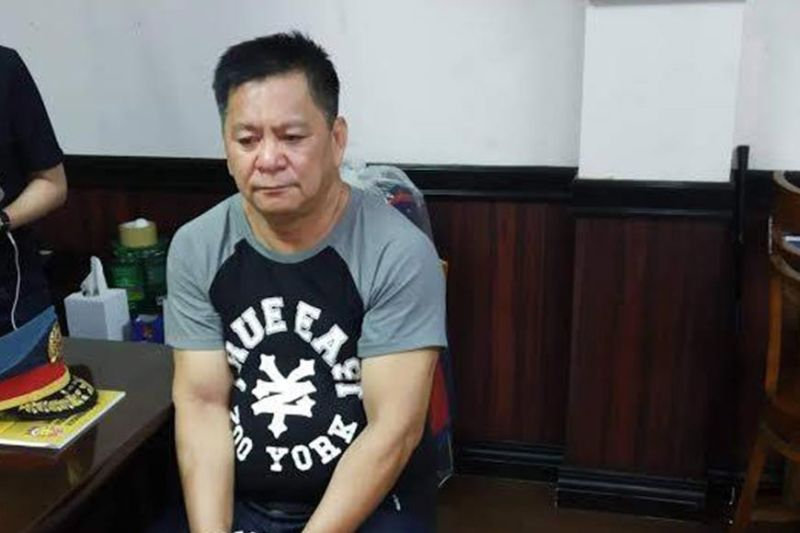 MANILA. Robel Canlas was arrested for posing as a member of the Philippine National Police and extorting money from applicants. (Photo from PNP-IMEG)