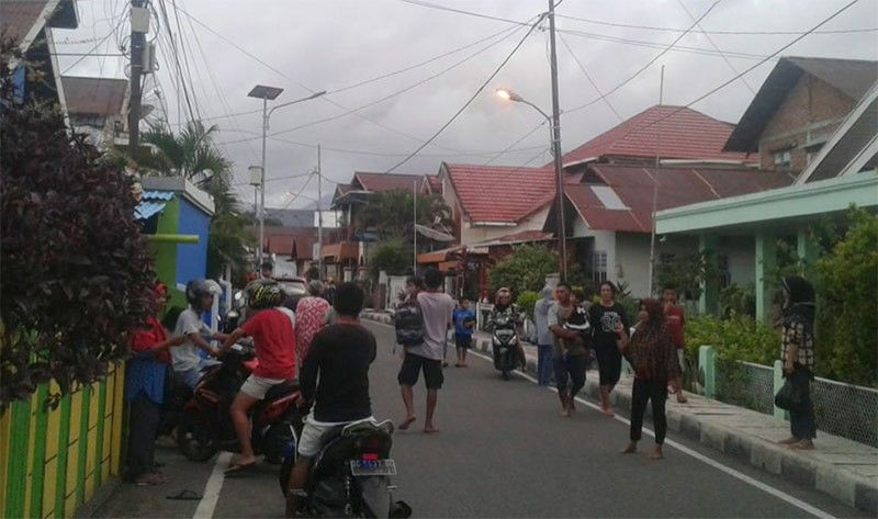 INDONESIA. Residents leave their homes to find higher grounds following an earthquake in Ternate, North Maluku, Indonesia, Sunday, July 14, 2019. A strong, shallow earthquake struck eastern Indonesia on Sunday, damaging some homes and causing panicked residents to flee to temporary shelters. There were no immediate reports of casualties, and authorities said there was no threat of a tsunami. (AP)