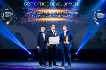 Leo T. Po (right), executive vice president and treasurer of ArthaLand and Edgar V. Sabidong (middle), vice president for technical services and chief sustainability officer, receive the award.