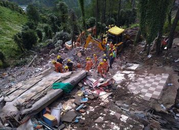 INDIA. Rescuers of India s National Disaster Response Force (NDRF) look for survivors after a three-story building collapsed in monsoon rains near the town of Solan, a hilly area 310 kilometers (195 miles) north of New Delhi, India, Monday, July 15, 2019. Rescuers were looking for half a dozen people, including some soldiers, still unaccounted for following Sunday's collapse. (AP)