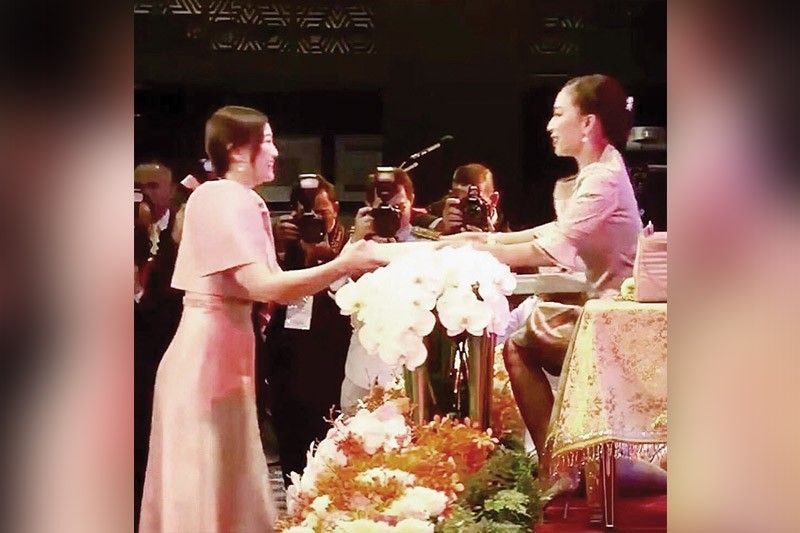 ASEAN AWARD. Chancellor Candice Gotianuy of the University of Cebu (UC) gets an Asean Women Entrepreneurs award from Her Royal Highness, Thai Princess Bajrakitiyabha Mahidol, during the awards night in Bangkok.