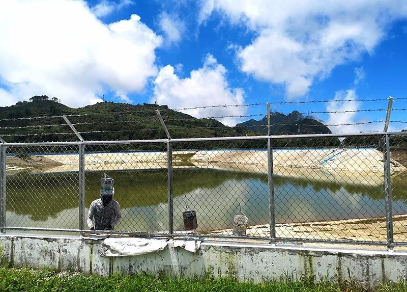 BENGUET. The rain harvesting facility in Cabuyao, Mt. Santo Tomas, Tuba, Benguet goes through maintenance, as water level in the seven-million gallon facility is in its half way mark. (Photo by Dave Leprozo Jr.)