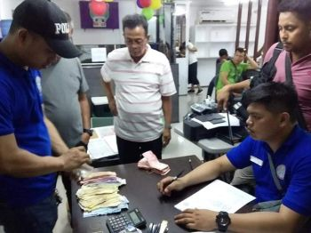 CARAGA. Authorities conduct inventory during an operation at the office of an alleged investment firm that is said to be a scam in Agusan del Sur. (Photo courtesy of PRO-Caraga)