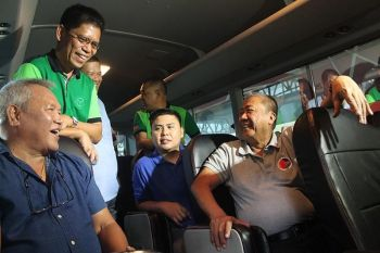 CAGAYAN DE ORO. Inside a coaster bus, Cagayan de Oro city mayor Oscar Moreno (left, sitting) talks with Land Transportation Franchising and Regulatory Board chairman Martin Delgra (left, standing) and Department of Transportation secretary Arthur Tugade (right, sitting), during the inaugural opening of Philippine Ports Authority's biggest passenger seaport terminal in Macabalan on Monday, July 15, 2019. (Jo Ann Sablad)