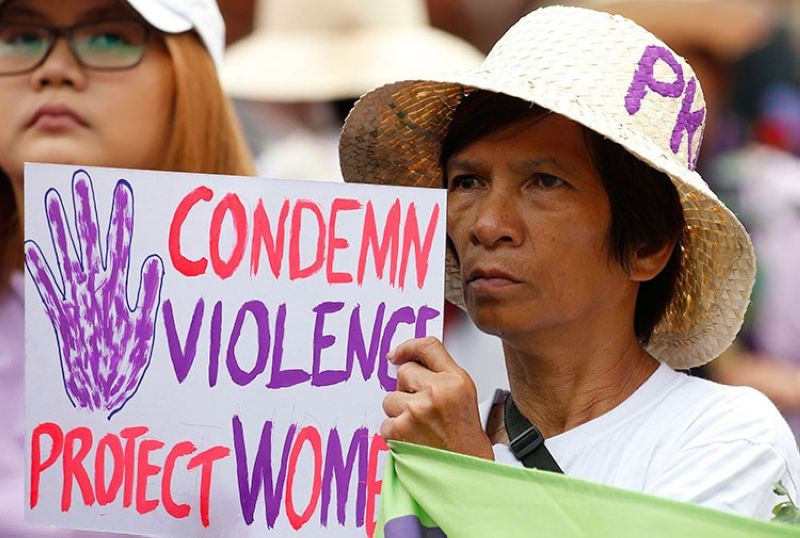 MANILA. In this March 8, 2018, file photo, a protester displays a placard during a rally to mark International Women's Day which largely turns out to be an anti-government event in Manila. (AP)