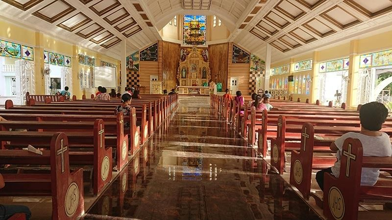 GLOSSY FLOOR. The sight of the glossy tiled floor of the Sto. Niño Roman Catholic Church in Santa Fe town in Bantayan Island, Cebu prompted the family of the bereaved to leave their muddied footwear outside its door. This photo was taken in November 2018. (SunStar Photo/Michelle So)