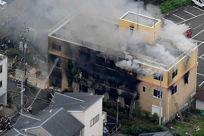 JAPAN. Smoke billows from a three-story building of Kyoto Animation in a fire in Kyoto, western Japan, Thursday, July 18, 2019. Kyoto prefectural police said the fire broke out Thursday morning after a man burst into it and spread unidentified liquid and put fire. (Kyodo News via AP)