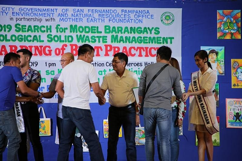 PAMPANGA. Mayor Edwin Santiago leads the awarding of best barangays in sound ecological solid waste management programs during the Search for Model Barangays on Ecological Solid Waste Management (ESWM) Awarding of Best Practices on July 16 at the Mini Convention Center, Heroes Hall. (Photo by CSF-CIO)