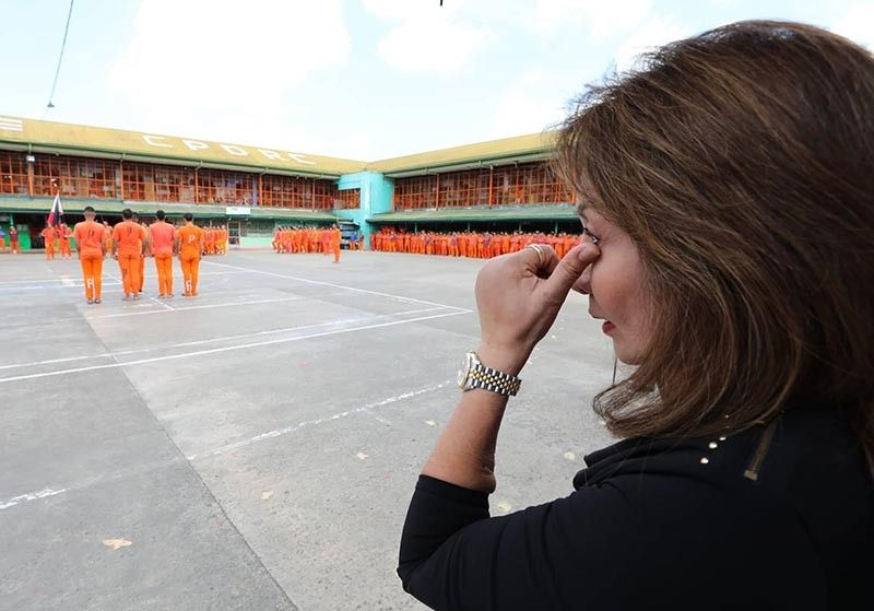 MOVED. Cebu Gov. Gwendolyn Garcia wipes the corner of her eye as she watches the formation of inmates, who surprise her with a dance routine during her visit at the Cebu Provincial Detention and Rehabilitation Center in Barangay Kalunasan, Cebu City on Thursday morning, July 18, 2019. (Contributed photo / Capitol PIO)