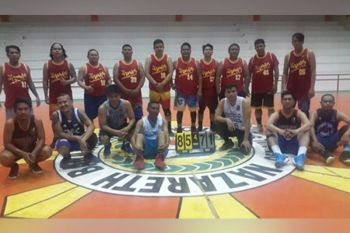 CAGAYAN DE ORO. Team Nobles dribblers strike a pose after eliminating Team Michael (at front row) on Wednesday night in the NMR-IV caging at the Nazareth gym, Cagayan de Oro. (Lynde Salgados)