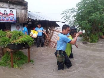 CAGAYAN DE ORO. Police officers under the 1005th Maneuver Company in Lanao del Norte help residents in Kapatagan to evacuate as some parts were flooded due to a heavy thunderstorm on Tuesday, July 18, 2019, when tropical depression was still making a landfall north of the country. (RMFTB 1005th Coy)