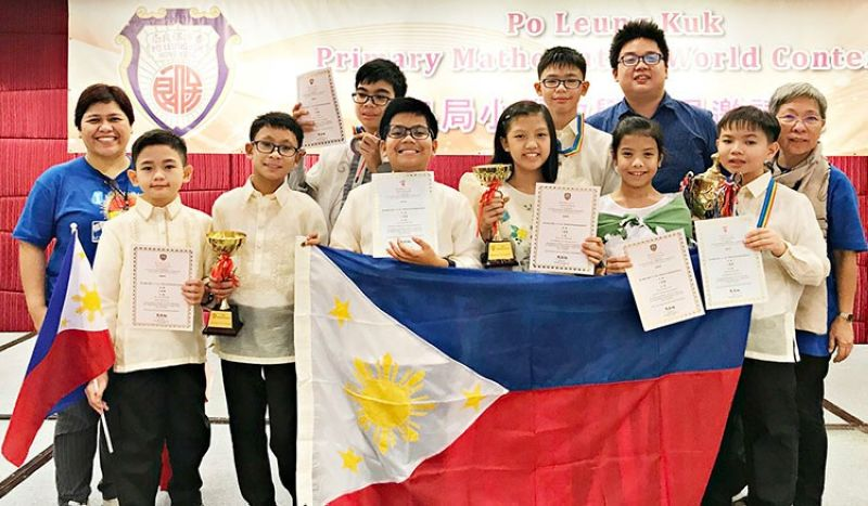 HONG KONG. Filipino students and their coaches at the awarding ceremony of the 22nd Po Leung Kuk Primary Mathematics World Contest in Hong Kong. (Photo by MTG)