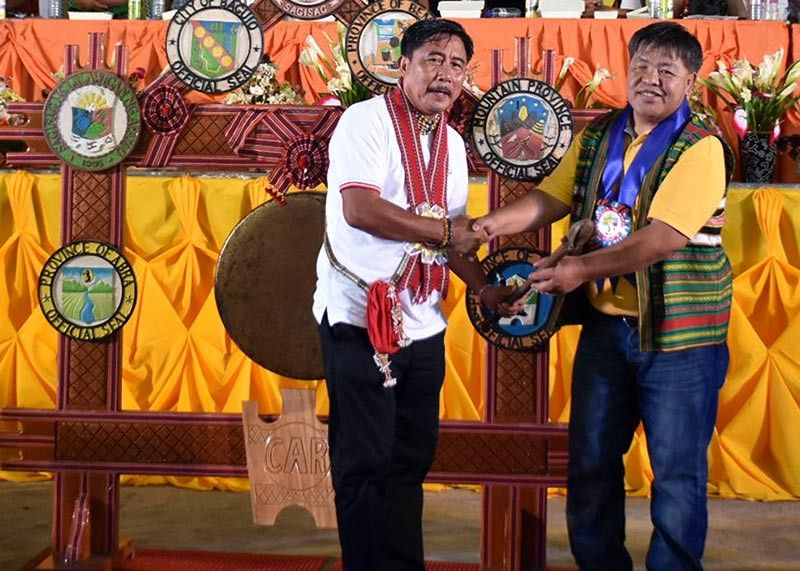 KALINGA. Kalinga officials led by Governor Ferdinand Tubban turns over the Cordillera Unity Gong to Mountain Province officials led by Governor Bonifacio Lacwasan during the 32nd Cordillera Day celebration in Tabuk City on Monday, July 15, 2019. (Redjie Melvic Cawis)
