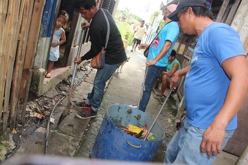 TACLOBAN. Personnel from Tacloban City Disaster Risk Reduction and Management Office and the City Health Office conduct mosquito fogging and cleaning operations in the city barangays following the rising number of dengue cases. (Photo courtesy of Tacloban City Information Office)