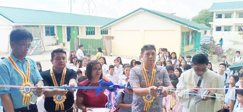 """PAMPANGA. Second District Congressman Juan Miguel """"Mikey"""" Arroyo and officials of DepEd and LGU of Lubao lead the recent blessing and inauguration of a newly constructed school building at San Roque Arbol High School in Lubao, Pampanga. (Chris Navarro)"""