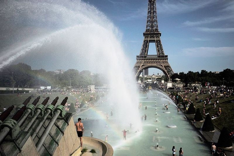 FRANCE. People cool off in the fountains of the Trocadero gardens, in front of the Eiffel Tower, in Paris, Friday, June 28, 2019. Schools are spraying kids with water and nursing homes are equipping the elderly with hydration sensors as France and other nations battle a record-setting heat wave baking much of Europe. (AP)