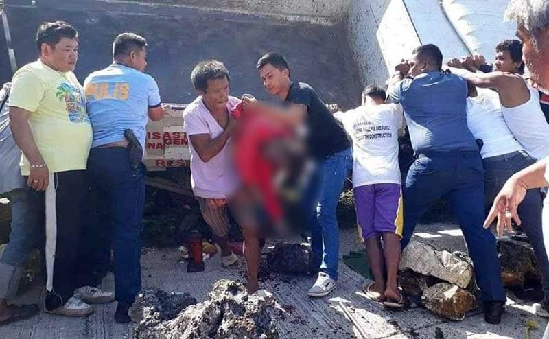 YOUNG GONE. Policemen and residents in Upper Becerril, Boljoon, Cebu retrieve bodies from a mini dump truck that fell on its side on July 19, 2019. Nine passengers were killed, most of them elementary school students. The use of government dump trucks to ferry people was banned in 2011. (Contributed Photo/Michael Dave Amaba)