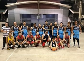 CAGAYAN DE ORO. Triumphant Team Gabe (in blue uniform) against Team Candia (at front row) at the close of the NMR-IV Eagles basketball's quarterfinal matches at the SPC covered court, Cagayan de Oro. (Contributed photo)