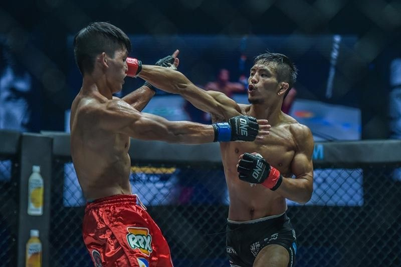 THE NEW. Yuya Wakamatsu trades punches against Danny Kingad during their match last year. Wakamatsu vowed to stop Kingad's teammate Geje Eustaquio at ONE: Dawn of Heroes on August 2. (ONE Championship photo)