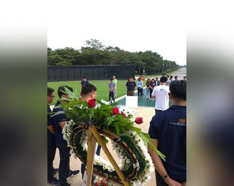 Finalists and organizers of The Outstanding Students of the Philippines TOSP Central Luzon offers flowers and prayers for the more than 31,000 Filipino and American soldiers who were incarcerated and died in the concentration camp (National Shrine Area) during the World War II. (Reynaldo G. Navales)
