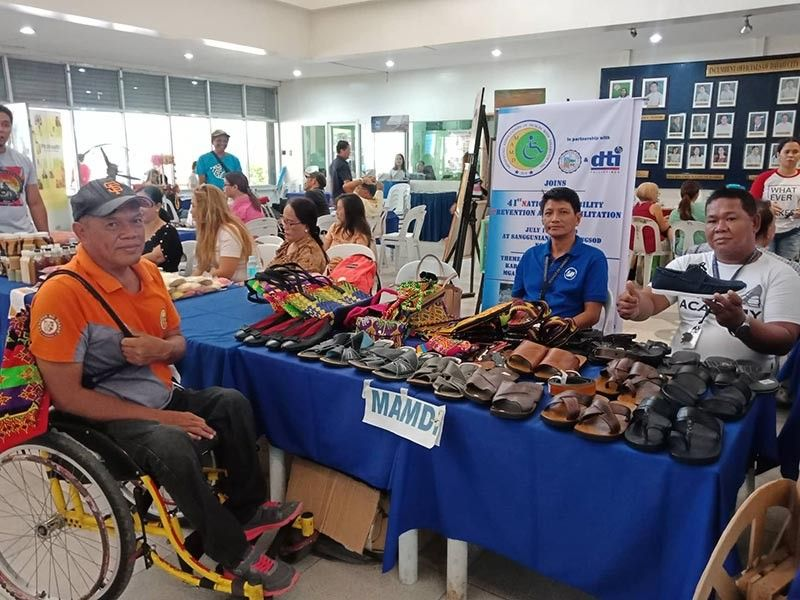 Mindanao Association of Muslims with Disability Inc. (MAMDI) president Allan Rasman and other members during their product exhibit at the City Council. (Lyka Casamayor)