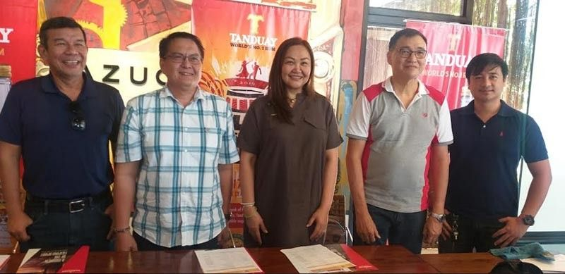 Former councilor Em Ang (center) with Tanduay Bacolod Branch head and sales nanager James Lim (second from right) and marketing officer Jay-R Infante (right), Hotel and Restaurant Association of Negros Occidental Roberto Magalona (left) and Rene Avelis of Philippine Airlines - Bacolod during the press conference on the first-ever Tanduay Rum Festival at Cafe Azucarera in Bacolod City yesterday. (Erwin P. Nicavera)