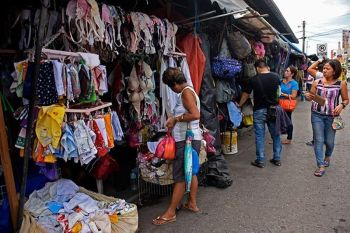 Used clothing remains popular among marketgoers at Agdao Public Market as these are much cheaper, and buyers can find good quality clothes for less than P100 where brand-new now costs over P1,000. (Mark Perandos)