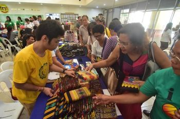 Spectators choosing what to buy on the products made by the persons with disabilities (PWD) at the Sangguniang Panlungsod. (Macky Lim)