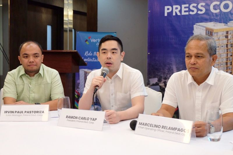 BULLISH. Priland Development Corp. president Ramon Carlo Yap (center) says the two-tower Vertex Coast will support high-end developments in Punta Engaño, Lapu-Lapu City. With him are Priland's sales manager Irvin Paul Pastoriza (left) and Priland's general manager Marcelino Relampagos. (CONRIBUTED FOTO / SINJIN PINEDA)