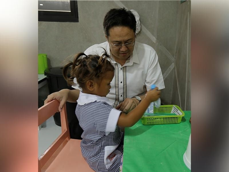 PAMPANGA. Clark Development Corporation (CDC) President and CEO Noel Manankil observes one of the Aeta students during the launch of the Pagsasarili Family Care Center.