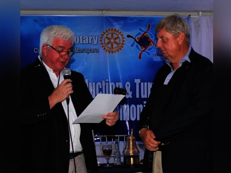 Dr. James Bilbao hands over the presidency to Kevan Broad.