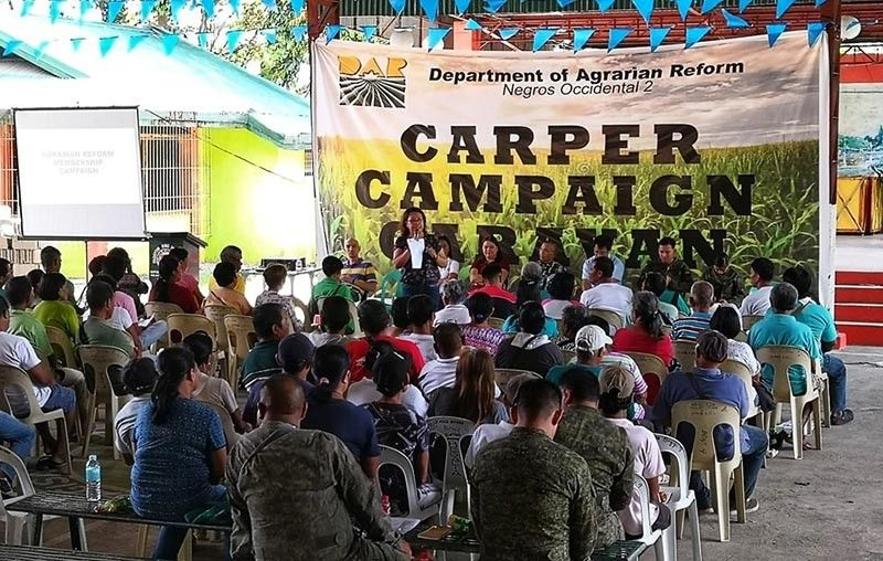 Farmer-beneficiaries in La Castellana attend a forum as part of the three-day Carper Campaign Caravan of the Department of Agrarian Reform in Negros Occidental – South recently. (Contributed photo)