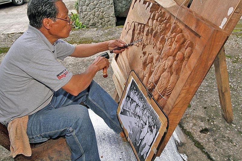BAGUIO. Master carver Ernesto Dul-Ang carve the surrender scene of Tiger of Malaya Japanese Imperial Army Gen. Tomoyuki Yamashita to Pacific Theater Supreme Commander Gen. Douglas McArthur in Camp John Hay, September 2, 1945, in Baguio 74 years ago. (Jean Nicole Cortes)