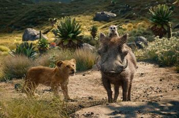This file image released by Disney shows, from left, young Simba, voiced by JD McCrary, Timon, voiced by Billy Eichner, and Pumbaa, voiced by Seth Rogen, in a scene from