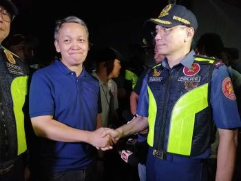 MANILA, NCR Police Director Guillermo Eleazar (right) shakes hands with Bayan secretary general Renato Reyes after the peaceful protest actions during the State of the Nation Address of President Rodrigo Duterte on July 22, 2019. (Photo by Third Anne Peralta-Malonzo/SunStar Philippines)
