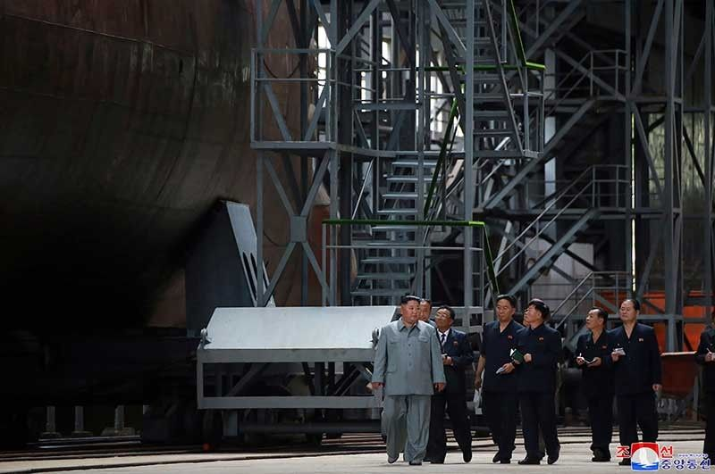 In this undated photo provided on Tuesday, July 23, 2019, by the North Korean government, North Korean leader Kim Jong Un, left, inspects a newly built submarine to be deployed soon, at an unknown location in North Korea. (AP)